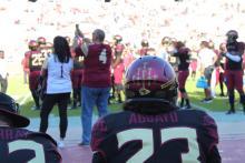 Veterans Alliance arrowhead on football helmet.